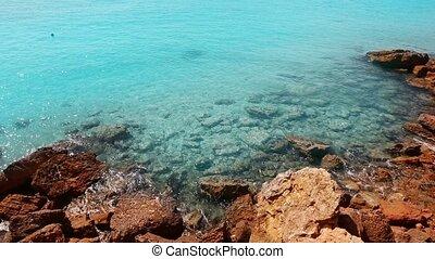 beautiful rocky beach in balearic islands with blue...