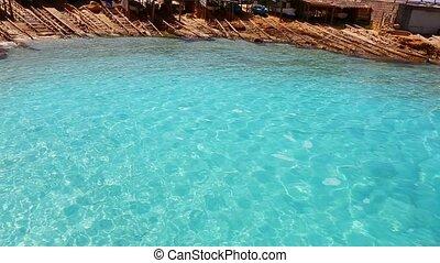 beautiful rocky escalo blue beach