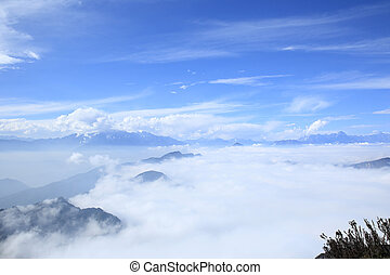 beautiful rolling clouds over mountain landscape