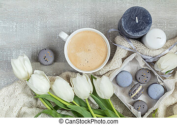 Beautiful romantic composition with coffee, sweet food and flowers