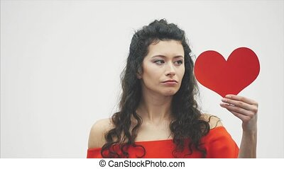 Beautiful romantic couple isolated on white background. Attractive young woman and handsome hand hug with red heart.