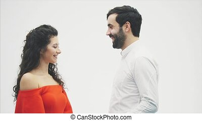 Beautiful romantic couple isolated on white background. Attractive young woman and handsome hand hug with red heart. Happy Valentine Kiss.