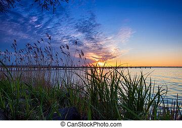 Beautiful romantic sunset over a calm lake