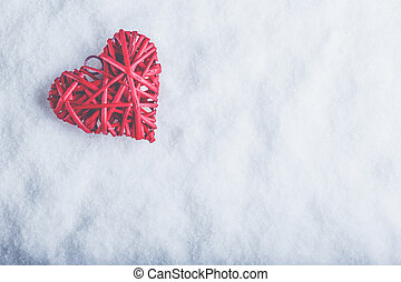 Beautiful romantic vintage red heart on a white snow...