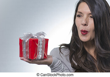Beautiful romantic woman holding a gift