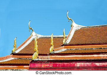 Beautiful roof of temple on blue sky background