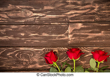 Beautiful rose on wood background. Valentine's day concept