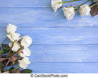 beautiful roses on wooden background frame
