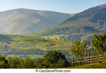 beautiful rural area in mountainous countryside. fence on...