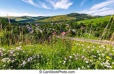 beautiful rural landscape in summertime. village along the...