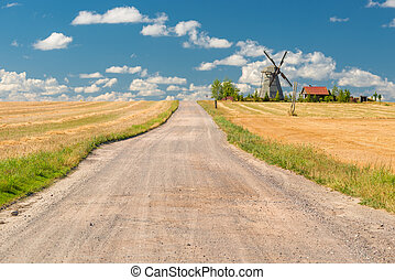 beautiful rural landscape with a windmill on a sunny day