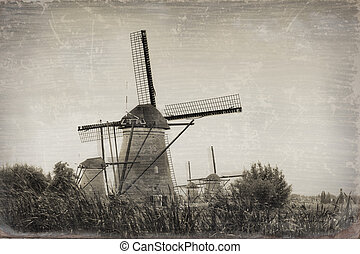 Beautiful rural landscape with windmills in Kinderdijk, Holland (stylization under an old card)