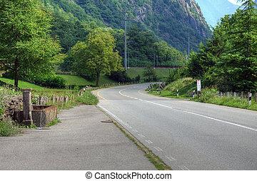 Beautiful rural road in swiss Alps, Europe.