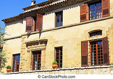 Beautiful rural sandstone house with shutter windows in Saint-Paul de Vence, Provence, France