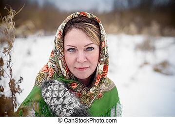 Beautiful Russian woman in a scarf
