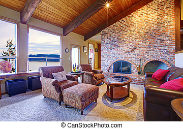 Beautiful rustic livingroom with fireplace and wood ceiling.