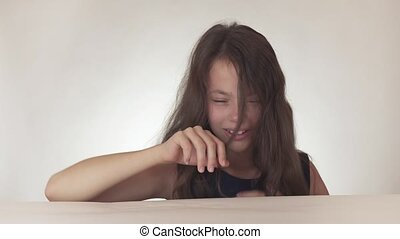 Beautiful sad teenage girl rolls a fit and freaks out on white background stock footage video