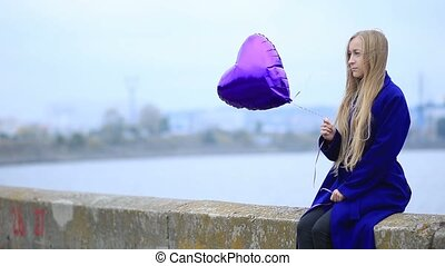 Beautiful sad woman with balloon - Beautiful sad blond woman...