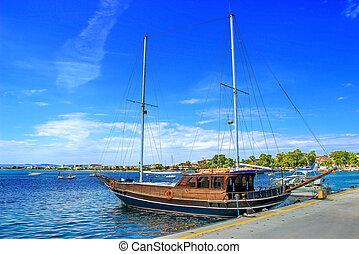 beautiful sailboat on blue sea