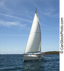 Beautiful sailboat on the Sea. Luxury yacht.