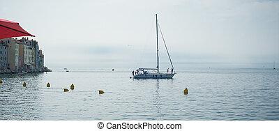 Beautiful sailboat sailing over ocean in beautiful blue mediterranean sea