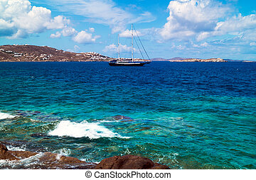 Beautiful sailboat sailing sail blue Mediterranean sea near Mykonos island, Greece