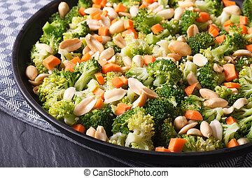 Beautiful salad of broccoli with peanut on a plate macro. horizontal