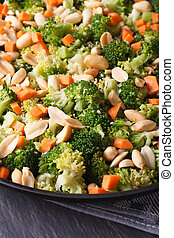 Beautiful salad of broccoli with peanut on a plate macro. vertical
