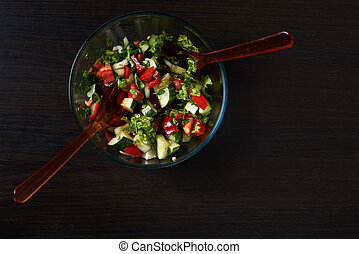 beautiful salad on the black wood background