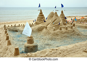 Beautiful sand castle with tower at the beach