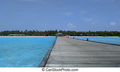 Beautiful sandy beach with a pier in the Maldives