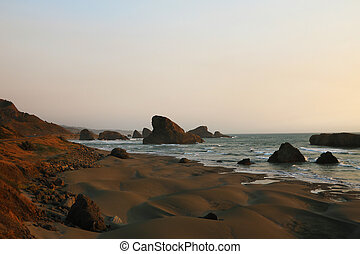 Beautiful sandy beach with cliffs on the Pacific coast