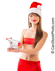 Beautiful Santa christmas girl with small shopping trolley on white background