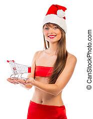Beautiful Santa christmas girl with shopping trolley