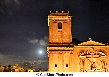 Church facade in a full moon night