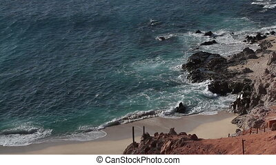 beautiful scene in los cabo, baja california sur mexico where the desert reaches right down to the pacific ocean. there is an amazing quality of light around this area