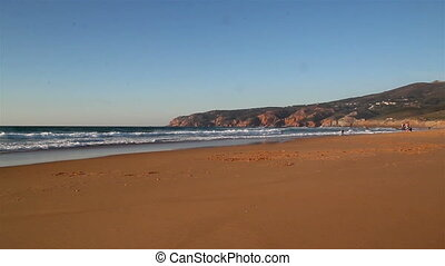 Beautiful scene of a beach with small waves - Wide shoreline...