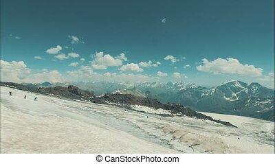 Beautiful scene tourists walking on snow mountain. Winter...