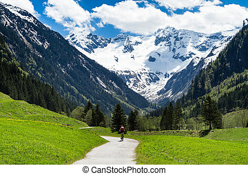 Beautiful scenery of Stiluptal on a sunny day with mountain peaks in the background. Stilluptal, Austria, Tyrol.