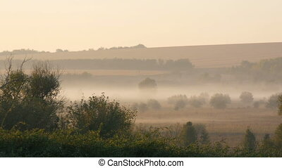 Beautiful scenic landscape of fog over the village plain
