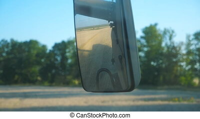 Beautiful scenic landscape reflecting in side mirror of...