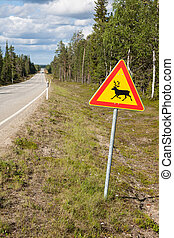 Beautiful scenic road in Norway. Typical warning road sign