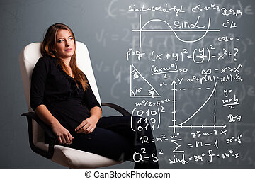 Beautiful school girl thinking about complex mathematical...