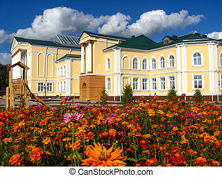 Beautiful school on a background of flowers