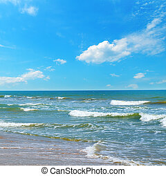 Beautiful sea and blue sky. Sand beach. The concept is travel.