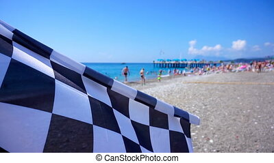 Beautiful sea beach. Finishing flag on the beach