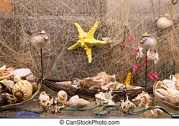 Beautiful sea composition with boat and shells on wooden background