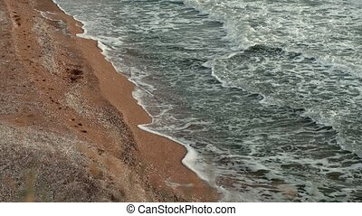 Beautiful sea landscape with sandy coast and dry grass above...