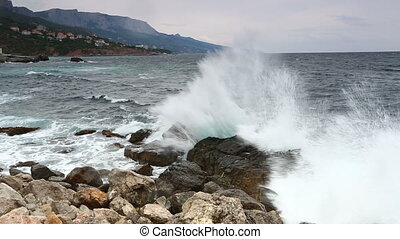 Beautiful sea landscape with waves and stones