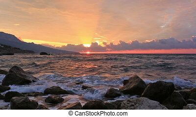 Beautiful sea landscape with waves and sunrise